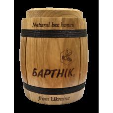 Natural honey in a wooden barrel 700 g.